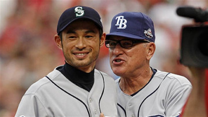 Ichiro Suzuki and Joe Maddon Rays manager Joe Maddon chats with Mariners outfielder Ichiro Suzuki before the game.
