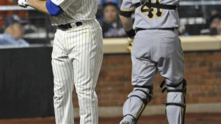 Ike Davis and Ryan Doumit The Mets' Ike Davis throws his bat behind Pirates catcher Ryan Doumit after striking out against Pirates pitcher Chris Resop for the third out in the ninth inning.
