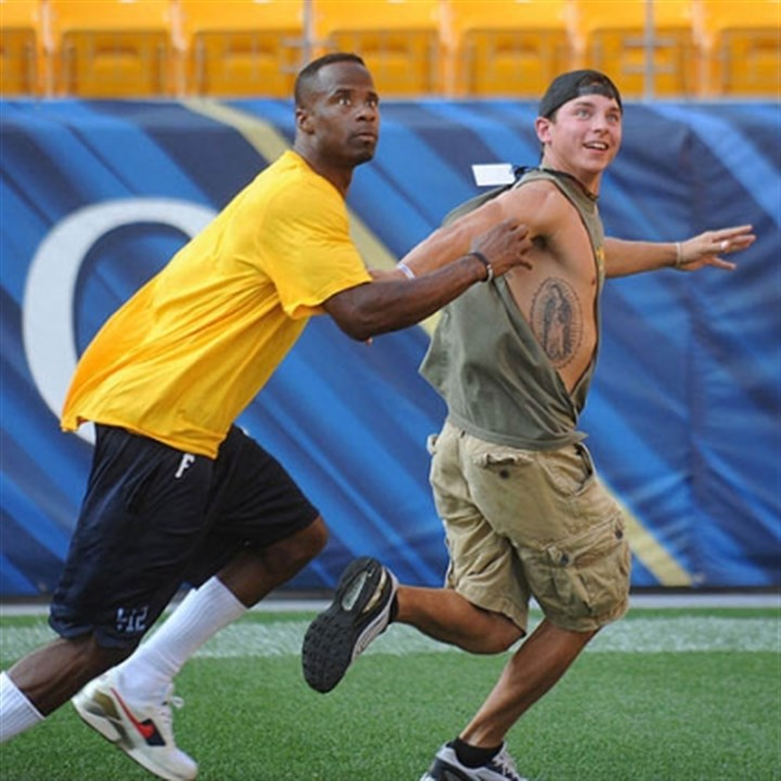 "ike taylor runs burniston Ike Taylor runs defense while United States Marine Corp. veteran Ryan Burniston, 28, of Erie looks for the ball. ""I get invited to do a lot of these things but this is the first one I've really wanted to attend,"" Burniston said."