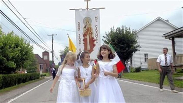 In 2004 In 2004: From left, Jenny Bell, 8, Courtney Hetherton, 7, and Alexa Stynchula, 8, throw flower petals during the Our Lady of Mount Carmel procession along Route 119 in Crabtree.