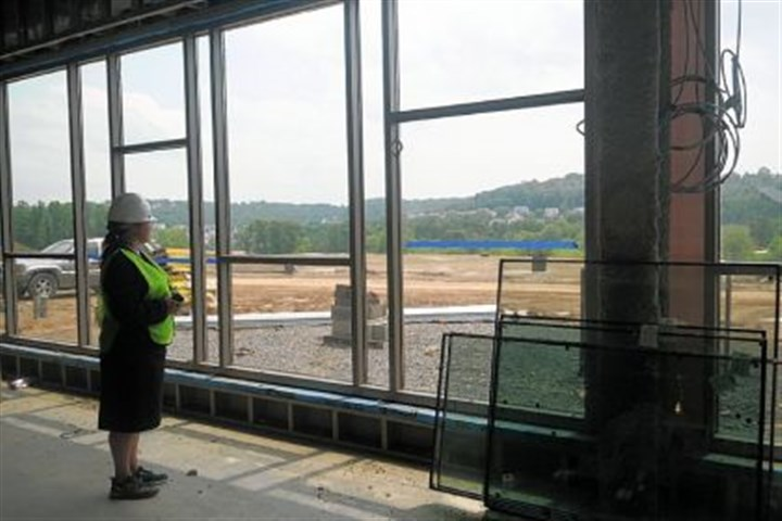 In the cafeteria Cardinal Wuerl North Catholic High School is under construction in Cranberry. Kellie Abbott, the school's new principal, is standing in what will be the cafeteria.