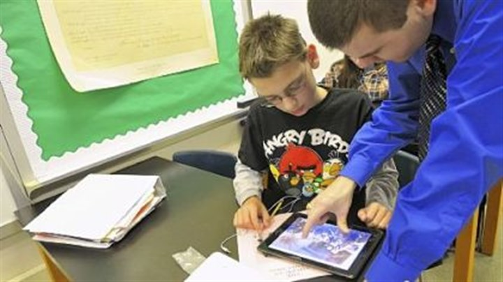 ipad classroom Eighth-grader Ben Deily, 13, works with his teacher Joe Welch, who helped develop a social studies book for North Hills Junior High Students using iBook Author, an app for tablets.