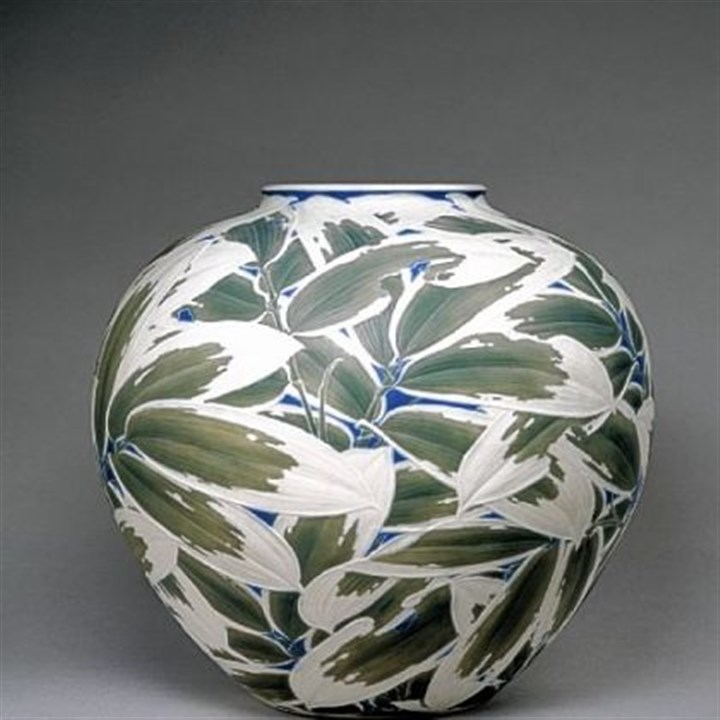 Itaya Hazan vase Itaya Hazan's training as a sculptor is clear in this carved porcelain vase that Henry Walters bought at the 1915 Panama-Pacific International Exposition held in San Francisco. Hazan's shallow relief of overlapping bamboo leaves are heightened by dark green and blue stains with a pure white matte finish.
