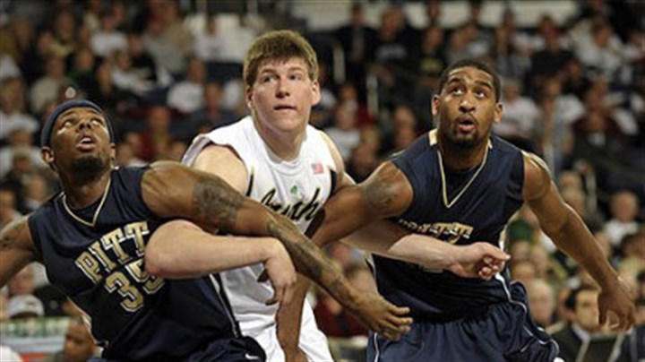 Jack Cooley, Nasir Robinson and Brad Wanamaker Notre Dame's Jack Cooley, middle, looks for a rebound between Pit's Nasir Robinson, left, and Brad Wanamkaer in the second half Wednesday's game in South Bend, Ind.