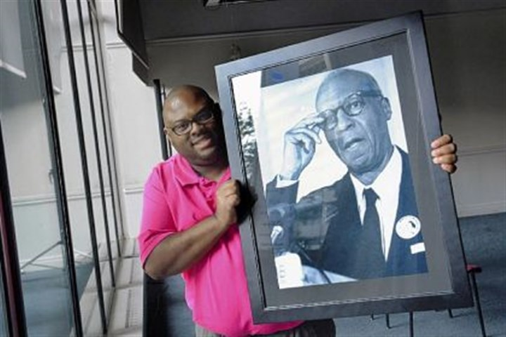 Jamaal L. Craig Jamaal L. Craig collects civil rights memorabilia. He's holding a photograph of A. Philip Randolph, organizer of the march.