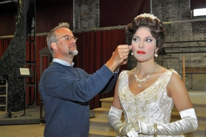 "James Geier and Vivica Genaux Pittsburgh Opera hair and makeup designer James Geier puts the finishing touches on Vivica Genaux's wig. The mezzo-soprano is starring in ""La Cenerentola,"" opening Saturday at the Benedum Center."
