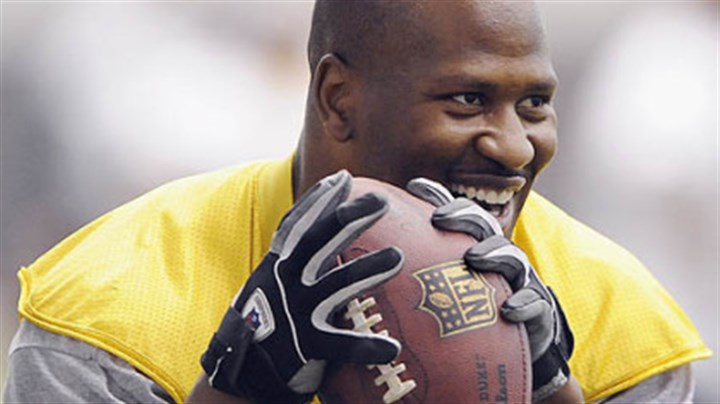 James Harrison Steelers linebacker James Harrison jokes around and drops back to pass to Hines Ward during minicamp workouts.