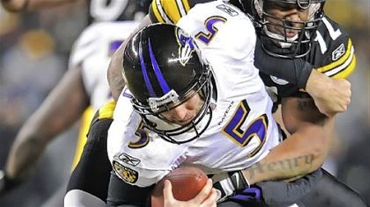 James Harrison takes down Joe Flacco James Harrison wraps up Baltimore's Joe Flacco last season.