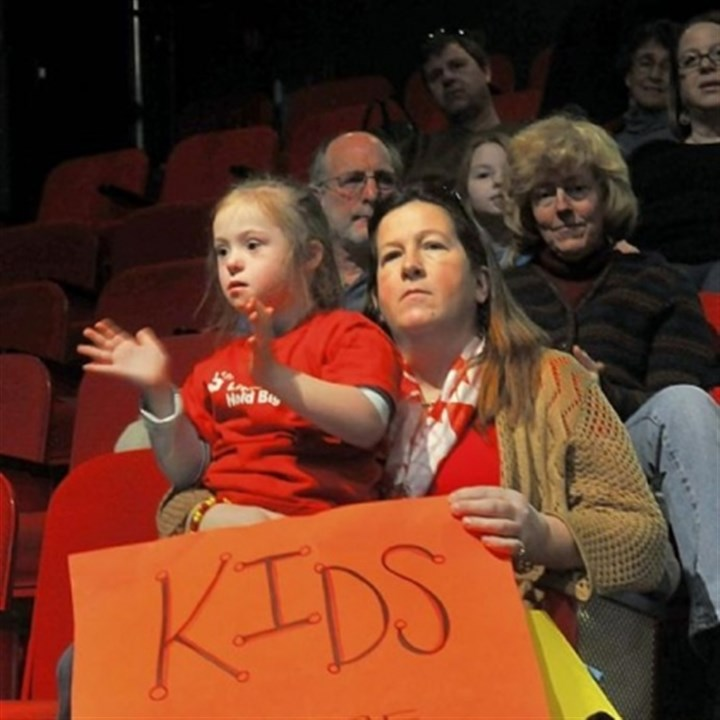 Jan Galbreath holds daughter Jan Galbreath holds her daughter Cayla, 7, a first-grader at Northgate Bellevue, as they listen to singer Anne Feeney at the education rally in the Kelly Strayhorn Theater.