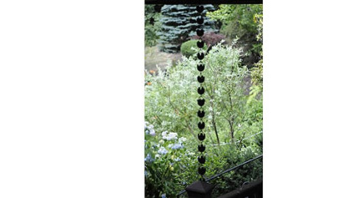 Japanese rain chain A Japanese rain chain hangs from the deck in Jerry and Monica Segal's garden.