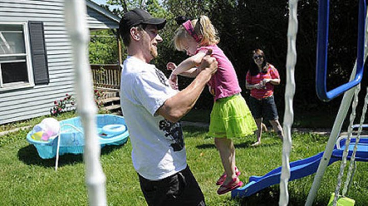 Jason Stiffler Jason Stiffler picks up his daughter, Holland Starr Stiffler, 2, while her mother, Rachel Bellaire, watches at their home Wednesday in North Fayette.