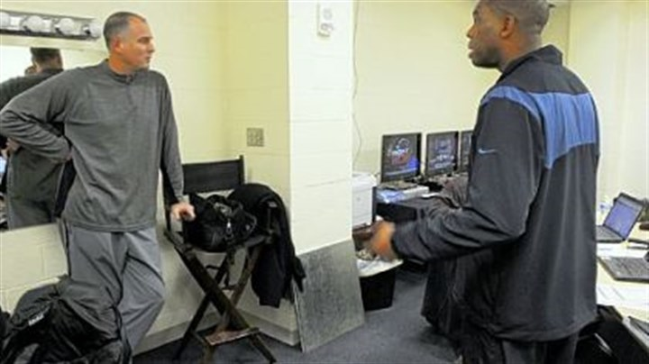 Jay Bilas, left, and Hubert Davis Bilas, left, and Hubert Davis confer in the production room in anticipation of the next day's telecast.