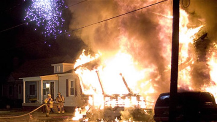 Jefferson County fire photo Sparks fly from two crossed power lines as firefighters confront the raging fire in Brockway in which at least eight people were killed.