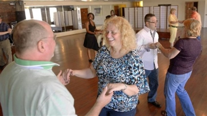 Jeffrey Kopf and Marylin Walther Jeffrey Kopf of Penn Hills and Marylin Walther of Iwrin learn to salsa at a fundraiser at the Pittsburgh Dance Studio in Bloomfield. Mr. Kopf is an amputee and part of the Embrace Dance Project there.