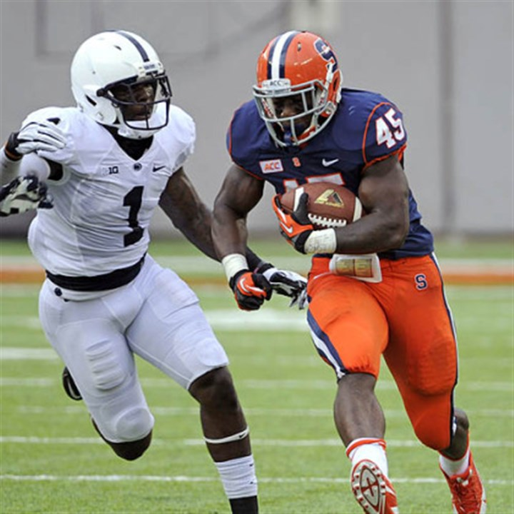 Jerome Smith and Malcolm Willis Syracuse running back Jerome Smith breaks away from Penn State safety Malcolm Willis during the first quarter.