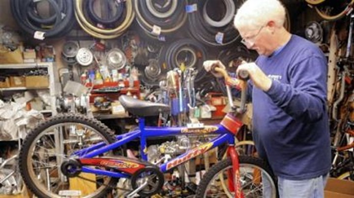 Jerry Kraynick Jerry Kraynick checks out a bike donated for his Bikes for Christmas program Monday in his store, Kraynick's Bike Shop.