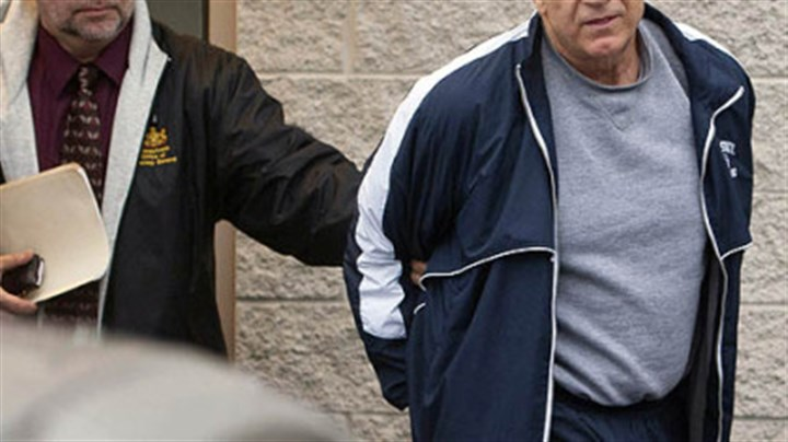 Jerry Sandusky Former Penn State assistant football coach Jerry Sandusky, right, leaves the office of Centre County District Justice Daniel A. Hoffman on Wednesday under escort by Pennsylvania State Police and Attorney General's Office officials in Bellefonte.