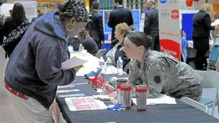Job fair Sharone Frazier, a nursing student at Community College of Allegheny County, talks with National Guard recruiter Brittany Graeves at the job fair last Thursday at CCAC North campus.