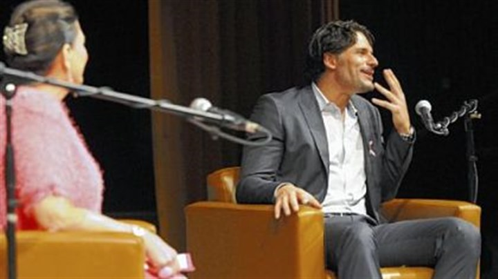 "Joe Manganiello Mt. Lebanon alumnus Joe Manganiello, who portrays a werewolf on HBO's ""True Blood,"" speaks at the high school Friday. At left is Cindy Schreiner, Mr. Manganiello's theater arts teacher there."