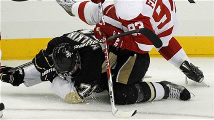 Johan Franzen and Evgeni Malkin Red Wings forward Johan Franzen collides with Penguins forward Evgeni Malkin during the first period.