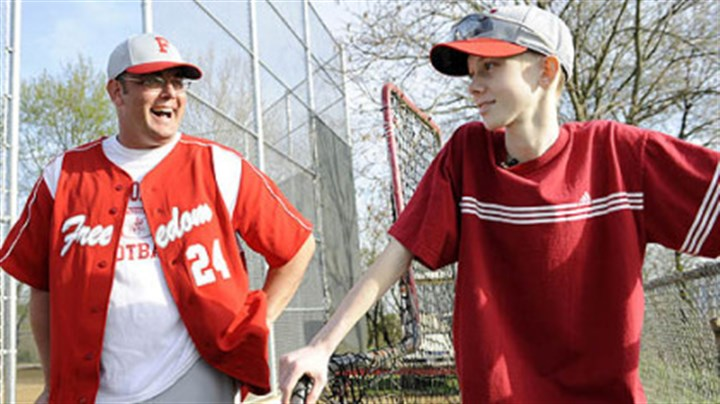 John Challis with baseball coach John Challis talks with Freedom High School head baseball coach Steve Wetzel after a game April 24.