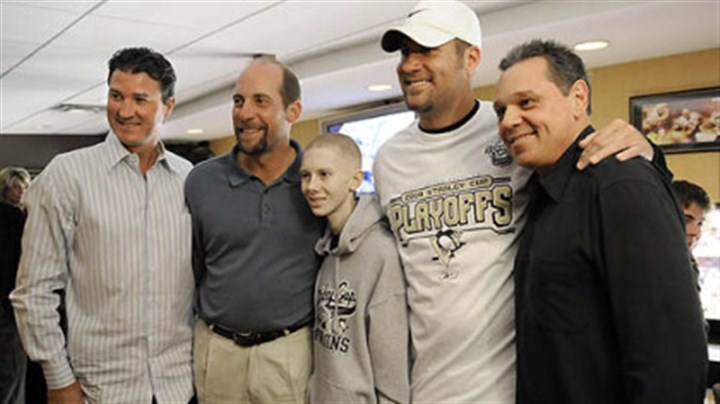 John Challis with Pittsburgh sports stars John Challis poses for a photo with Penguins owner Mario Lemieux, Atlanta Braves pitcher John Smoltz, Steelers quarterback Ben Roethlisberger and ex-Penguins star Pierre Larouche during the Penguins game against the Flyers on May 11.