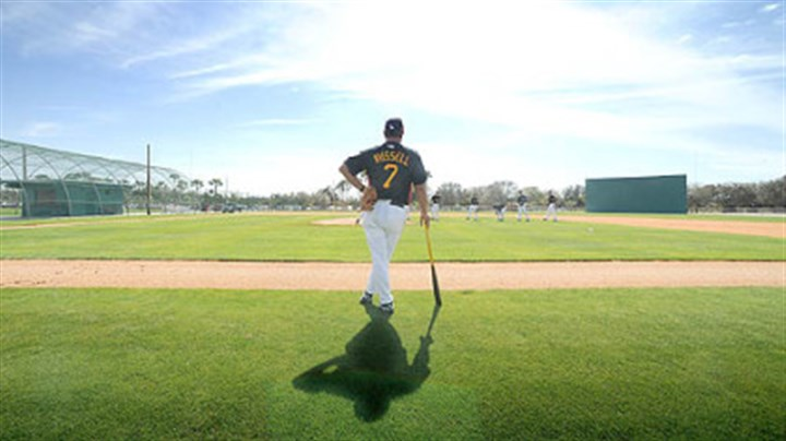 John Russell Manager John Russell watches pitchers during workouts at Pirate City on his first day as skipper of the Pittsburgh Pirates.