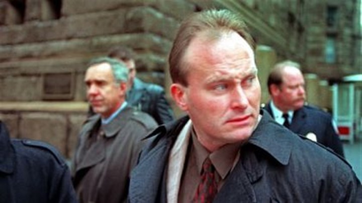 John Vojtas November 1996: Brentwood police Officer John Vojtas looks away from protesters in front of the Allegheny County Courthouse, as he and his legal team cross Grant Street during a recess in now-Sgt. Vojtas' trial.