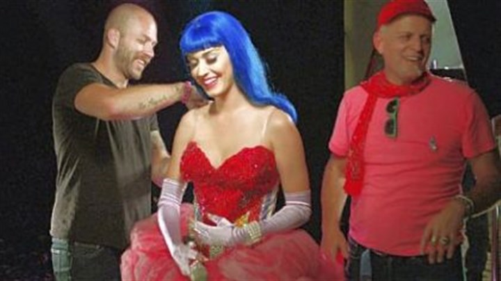 "Johnny Wujeck and Katy Perry Stylist Johnny Wujeck, left, prepares Katy Perry before the singer takes the stage in ""Katy Perry: Part of Me,"" opening today."