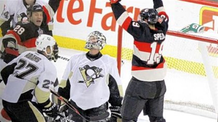 Johnson Penguins goaltender Brent Johnson looks up as the Senators' Jason Spezza (19) and Zenon Knopka (28) celebrate Knopka's goal in the second-period Friday in Ottawa, Ontario.