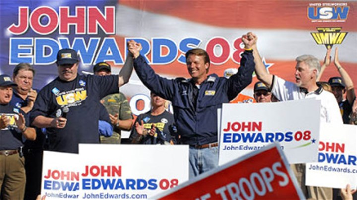 Joining hands John Edwards joins hands with United Steelworks president Leo Gerard, left, and United Mine Workers president Cecil Roberts after the unions announced their endorsement of him for president at a rally at the Mellon Arena.