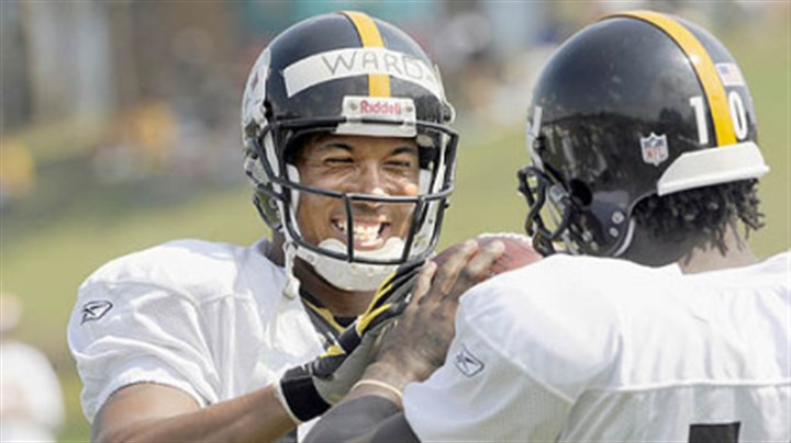 Jokes Hines Ward jokes with teammate Santonio Holmes.