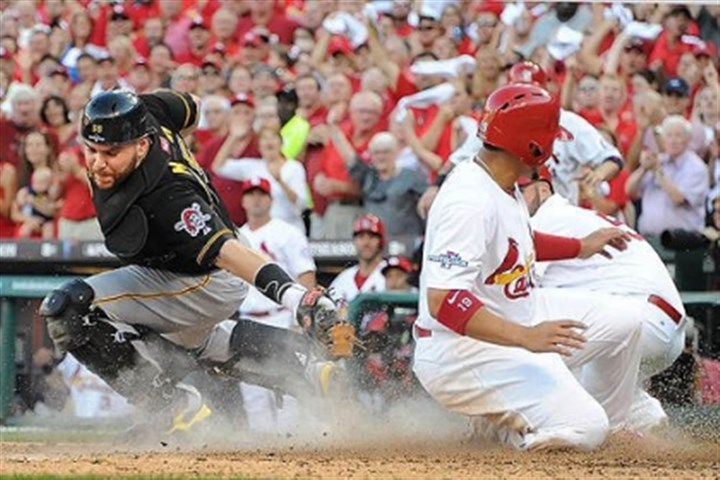 Jon Jay and Russell Martin The Cardinals' Jon Jay slides safely past the reach of Pirates catcher Russell Martin during the National League Division Series game at Busch Stadium in St. Louis.