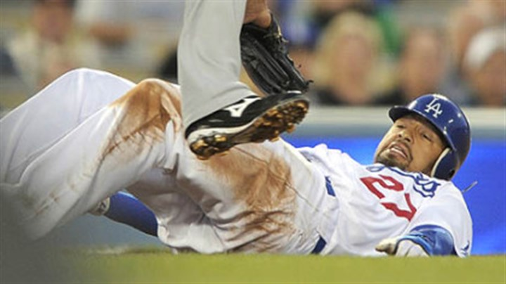 Jose Bautista Dodgers right fielder Matt Kemp ducks under the tag of the Pirates' third baseman Jose Bautista between second and third base as he is caught in a rundown during the first inning of last night's baseball game, in Los Angeles. Kemp made it safely to third on the play.