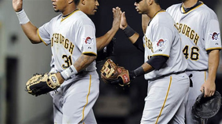 Jose Tabata, Octavio Dotel, Pedro Alvarez and Garrett Jones The Pirates' Jose Tabata, Octavio Dotel, Pedro Alvarez and Garrett Jones, from left, congratulate each other after beating the Rockies, 4-2, Tuesday at Coors Field.