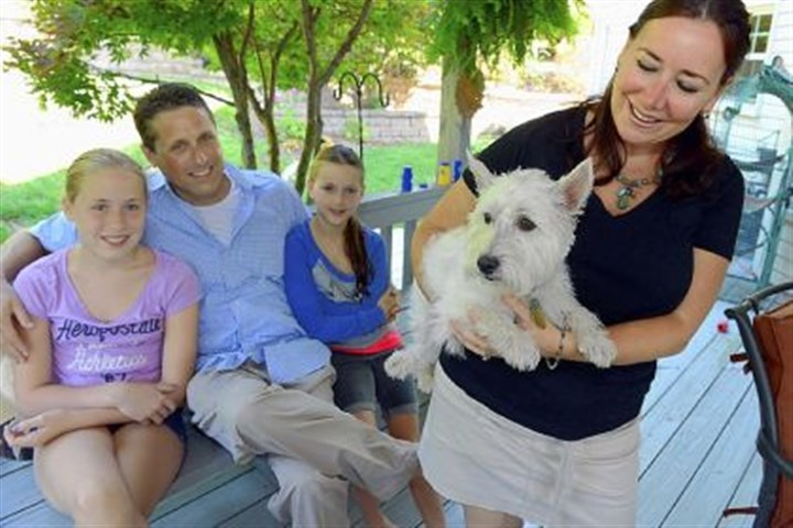 joshua the dog The late Bishop Anthony Bosco's West Highland terrier, Joshua II, is now living with the bishop's relatives in Mt. Lebanon. From left are Anna, Jim Jr., Juliet and Beth Bosco.