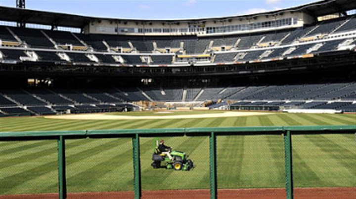 Just a trim The outfield of PNC Park get trimmed up as the ballpark is whipped into shape for the home opener on Monday.