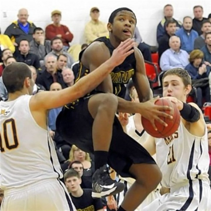 JustinHill Montour's Justin Hill drives to the basket against Mars' Owen Nearhoof and Matt Getsy Tuesday in a Class AAA semifinal. Montour defeated Mars, 61-52.