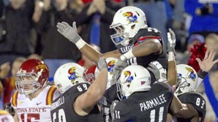 Kansas.jpg Kansas running back James Sims (29) celebrates with teammates after a big play as Iowa State defensive lineman Ben Durbin (15) walks off the field during the first half in Lawrence, Kan., Saturday, Nov. 17, 2012.