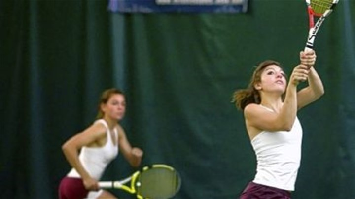 Karli and Tanya Timko Chartiers-Houston sisters Karli Timko, left, and Tanya compete against Harrisburg Academy's Andrew Kantor and Ted Otto in a PIAA first-round boys' doubles match yesterday at the Hershey Racquet Club.