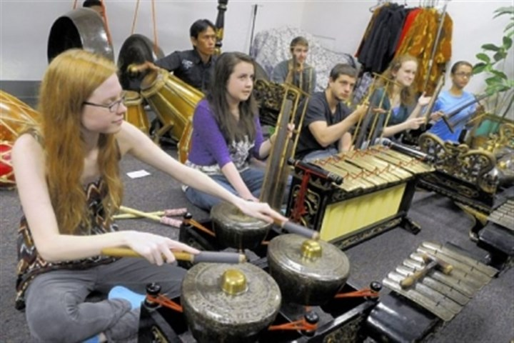 Kaura Ronemus, left, Heidi Cousineau Kaura Ronemus, left, Heidi Cousineau, center, and others rehearse for the University of Pittsburgh Gamelan, an ensemble of Indonesian brass instruments with drums.