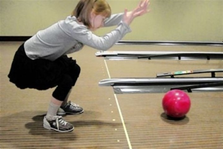Kayleigh Wilson-Reilly Kayleigh Wilson-Reilly, 8, uses a two-handed technique to bowl with other special needs children during the PALS program and pizza party at Latitude 40 at The Pointe at North Fayette.