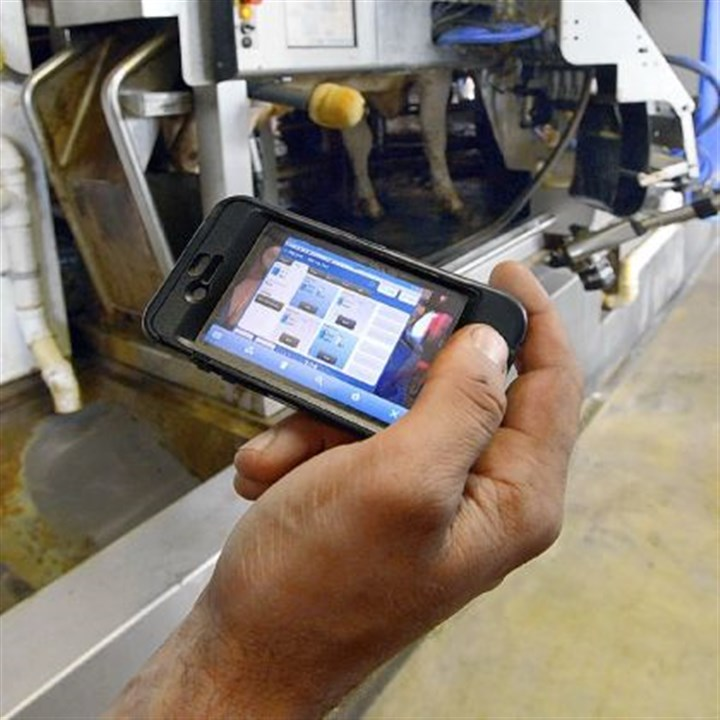 Keeping track Mike Kepple can monitor and control his family's robotic milking machines with his iPhone.
