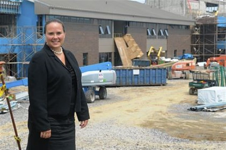 Kellie Abbot The new principal of Cardinal Wuerl North Catholic High School, Kellie Abbot of New Kensington, stands in front of the construction site in Cranberry.