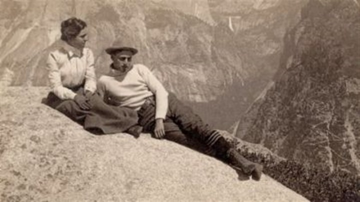 Ken Burns National Parks documentary Lounging on Eagle Rock in Yosemite National Park, circa 1902, with Half Dome and Nevada Falls in the background.