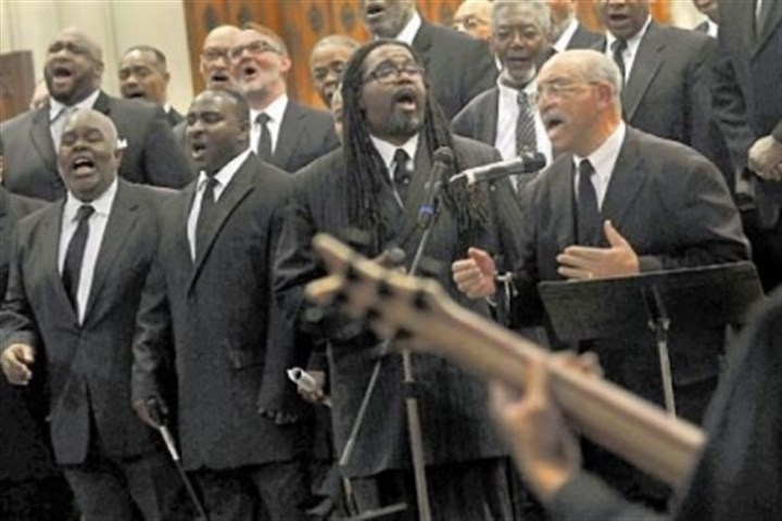 "Ken Fair sings with DeCarlo Gilliard Ken Fair, right, sings with DeCarlo Gilliard, center, as the Rodman Street Missionary Baptist Church men's choir sings ""God Will Deliver On Time"" at the start of ""A Celebration of the Life and Witness of the Rev. Dr. Martin Luther King, Jr."" on Sunday at the East Liberty Presbyterian Church."