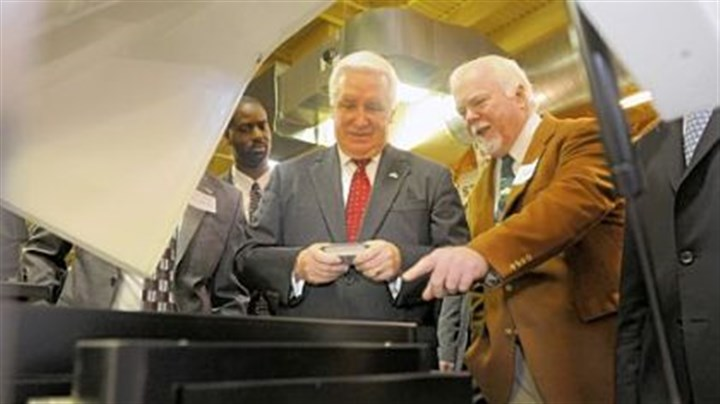 Kent Rockwell, Gov. Tom Corbett Kent Rockwell, chairman and CEO of ExOne, right, shows Gov. Tom Corbett parts manufactured by ExOne in North Huntingdon during a visit to Acutronic.