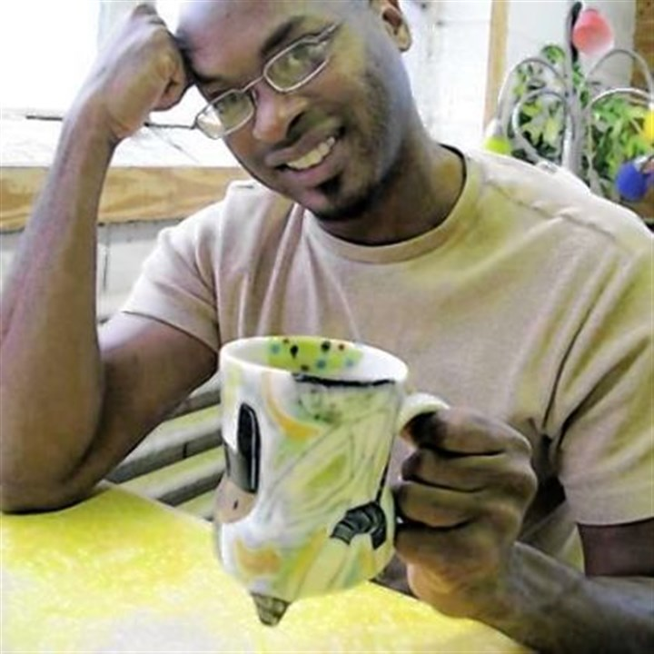 Kevin Snipes Chicago ceramist Kevin Snipes, with one of his mugs, will teach and speak here on Monday.