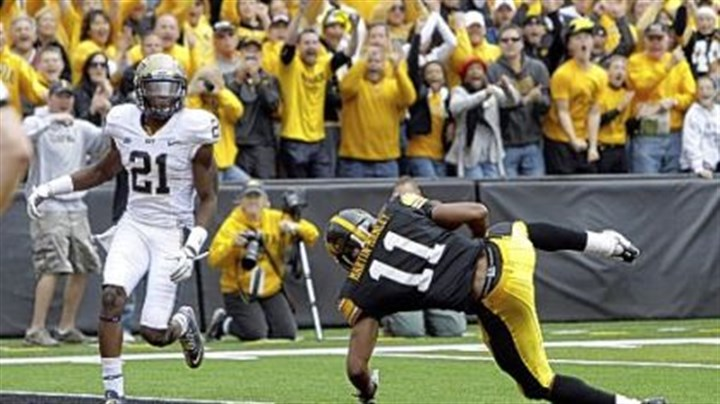 Kevonte Martin-Manley Iowa wide receiver Kevonte Martin-Manley (11) tumbles into the end zone with a 22-yard touchdown catch in front of defensive back Buddy Jackson in the fourth quarter. The touchdown was part of a 21-point comeback by the Hawkeyes.