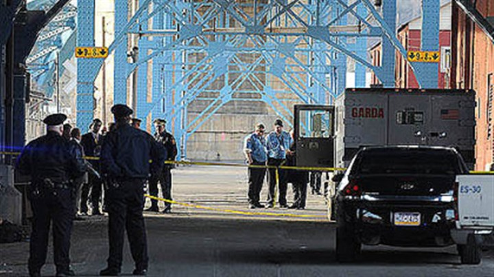 Konias Pittsburgh police comb the Garda armored truck and the area where it was found Feb. 28 under the 31st Street Bridge.
